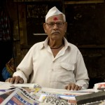 31.12.12 Dharavi 'The biggest slum of the east' in Mumbai, India, an old man sell newspapers at the roadside. Photo by Sam Burton, Taunton.jpg copy