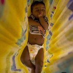 A young baby sleep suspended from the ceiling taken on 14.11.12 in Coimbatore, india, Photo Sam Burton of Taunton copy
