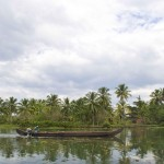 Taken on 05.12.12, In the backwaters near Kochi, Kerala, India, a narrow boat goes upriver to collect more crops. Sam Burton copy